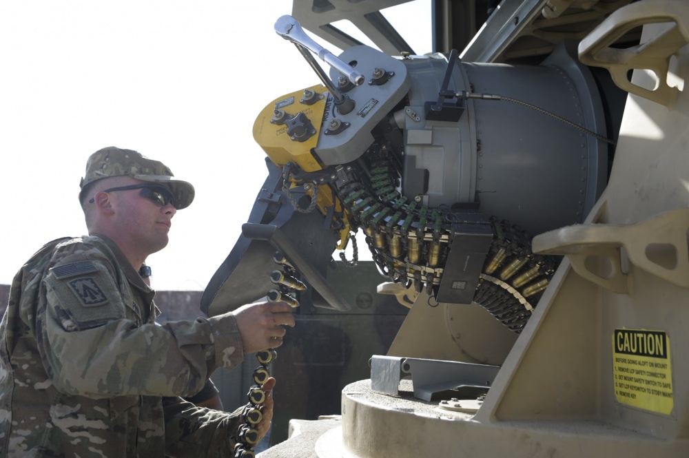U.S. Army Specialist James Finn, B Battery, 2nd Bn 44th Air Defense Artillery Regiment, loads rounds into a Counter Rocket, Artillery and Mortar system at Bagram Airfield, Afghanistan. (Photo, Ben Santos, US Forces Afghanistan public affairs)