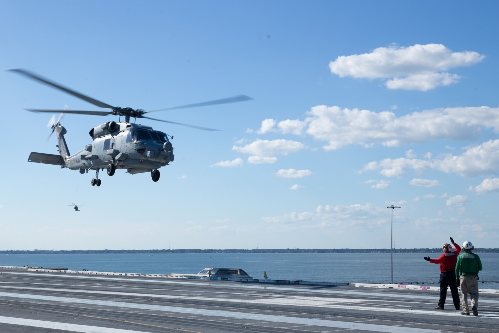 "An MH-60R Sea Hawk attached to the ""Spartans"" of Helicopter Maritime Strike Squadron (HSM) 70 approaches the flight deck of USS Gerald R. Ford (CVN 78) during flight operations Aug. 30, 2020."