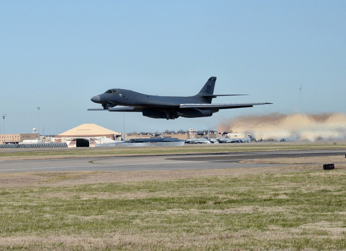 A B-1B Lancer bomber from Dyess Air Force Base, Texas, takes off from Tinker AFB, Okla., Dec. 15, 2015, following completion of the Integrated Battle Station modification.