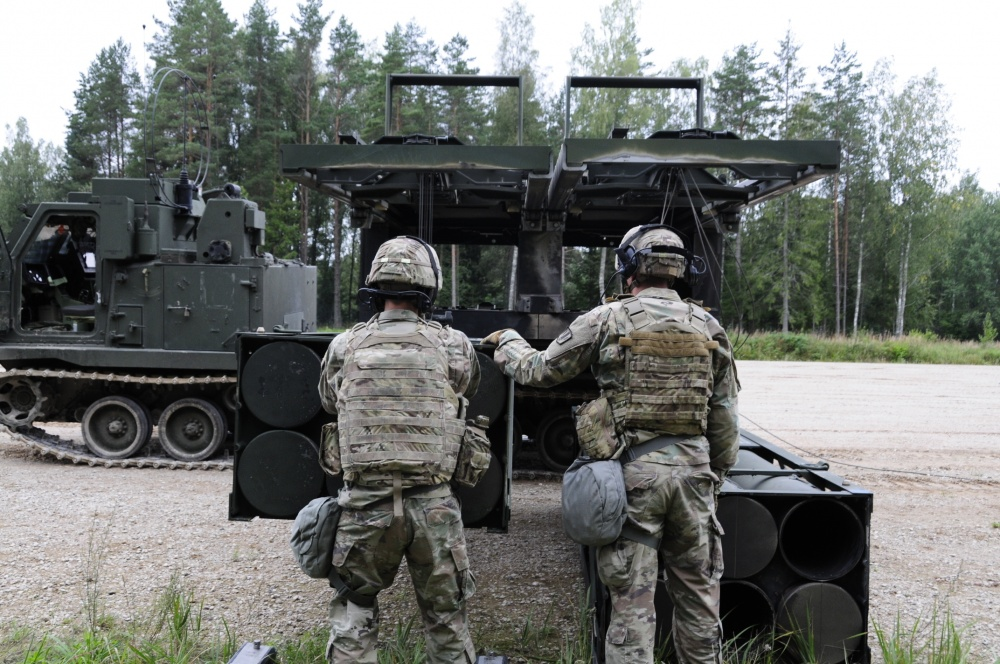 Soldiers assigned to Bravo Battery, 1st Battalion, 6th Field Artillery Regiment load training rounds into their Multiple Launch Rockets Systems during a NATO allied live fire Exercise in Tapa, Estonia Sept. 5, 2020.