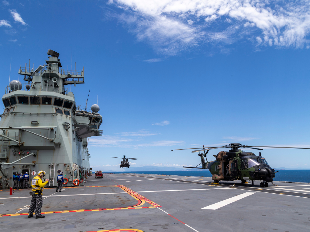 A Republic of Singapore Airforce CH-47 Chinook helicopter lands onboard HMAS Adelaide during Exercise SEA WADER 2020, off the coast of Townsville, Queensland.