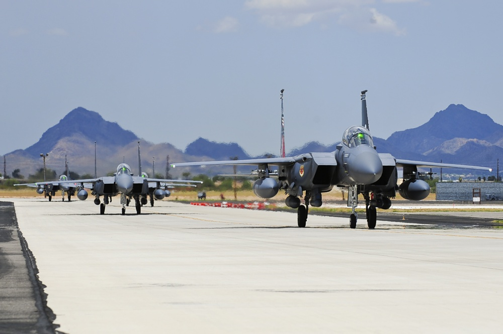 F-15SG fighter jets from the 428th Fighter Squadron at Mountain Home Air Force Base, Idaho, taxi from the runway at Davis-Monthan Air Force Base, Ariz., July 7, 2015. Ten of the fighter jets arrived to train at D-M until Aug. 24 while MHAFB's runway is closed for maintenance. (U.S. Air Force photo by Airman 1st Class Chris Drzazgowski/Released)
