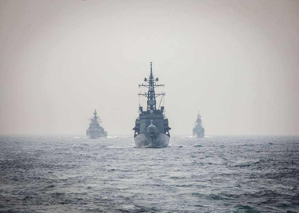 Ships from the Indian Navy, Royal Australian Navy, and Japan Maritime Self-Defense Force make their approach toward the Arleigh Burke-class guided-missile destroyer USS John S. McCain (DDG 56) while conducting replenishment-at-sea approaches (RASAPs) as part of Malabar 2020.