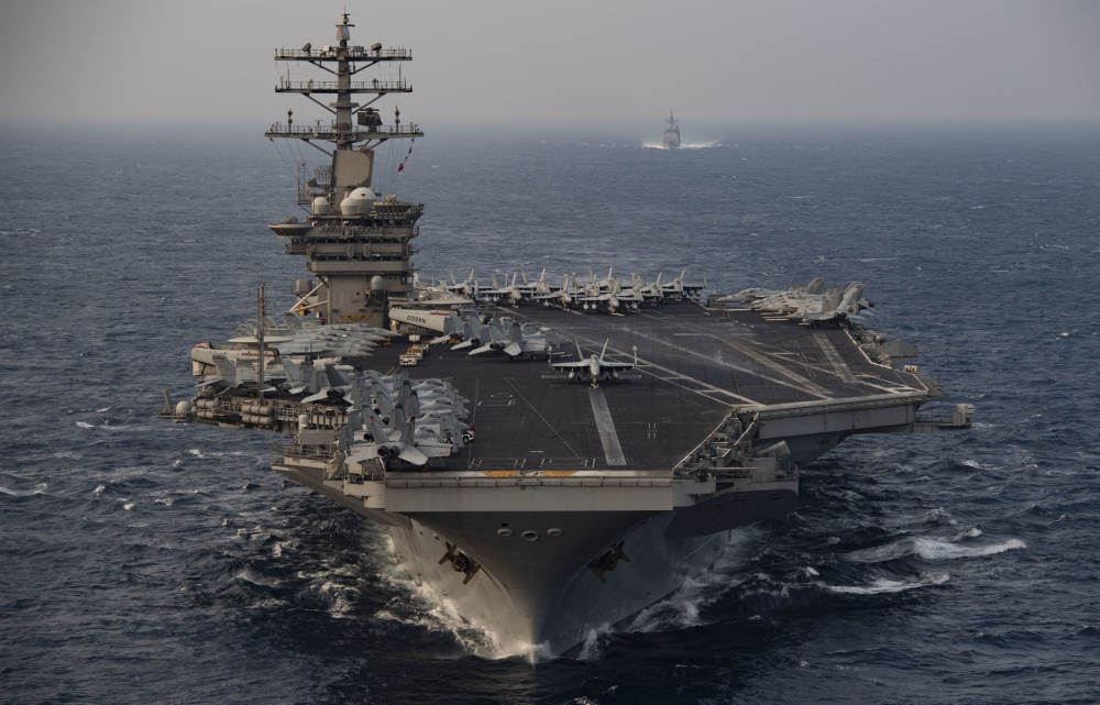 The aircraft carrier USS Nimitz (CVN 68) steams ahead of the guided-missile cruiser USS Princeton (CG 59) while participating in Malabar 2020 in the North Arabian Sea.