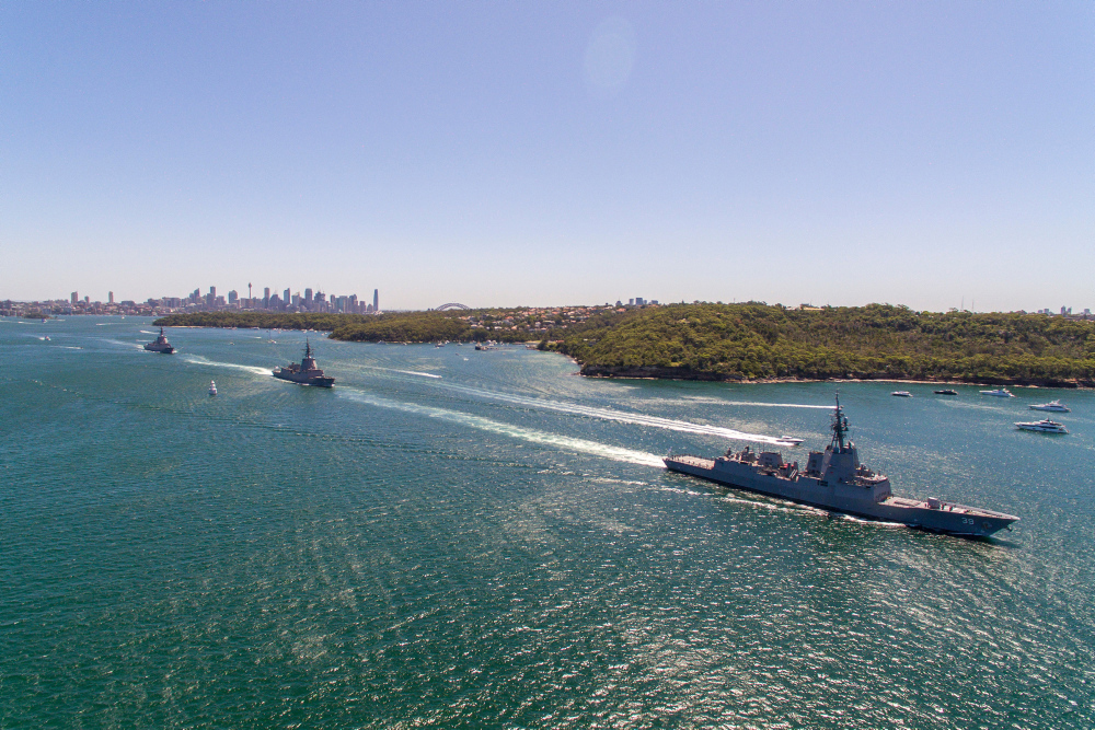 HMA Ships Sydney, Brisbane, and Hobart leave Sydney Harbour to conduct sea trials.