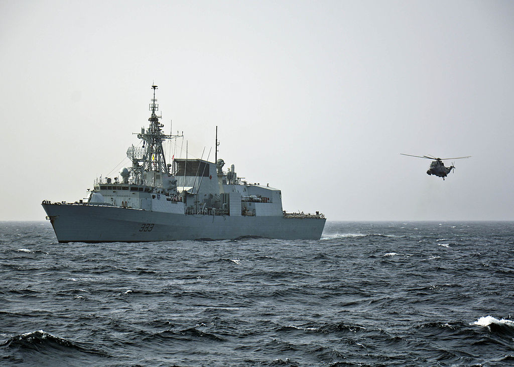 The Royal Canadian Navy frigate HMCS Toronto (FFH 333) launches a helicopter during a ship boarding exercise in the Alboran Sea east of Gibraltar with the U.S. Navy guided-missile cruiser USS Leyte Gulf (CG-55), flagship of the Standing NATO Maritime Group (SNMG) 2.