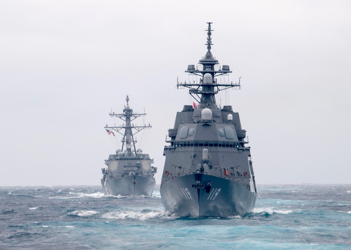 The Japan Maritime Self-Defense Force Asahi-class destroyer JS Asahi (DD 119), front, and the Arleigh Burke-class guided-missile destroyer USS John Finn (DDG 113) transit the Pacific Ocean on Jan. 15, 2021.