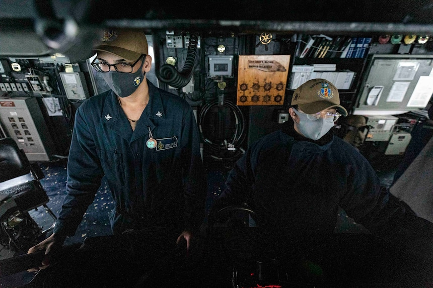 Boatswain's Mate 3rd Class Jonni Melo, left, from New York, and Boatswain's Mate 3rd Class Nicole Zapata, from Tampa, Florida, stand watch in the pilot house aboard the guided-missile destroyer USS John S. McCain (DDG 56) while the ship conducts routine underway operations in support of stability and security for a free and open Indo-Pacific.