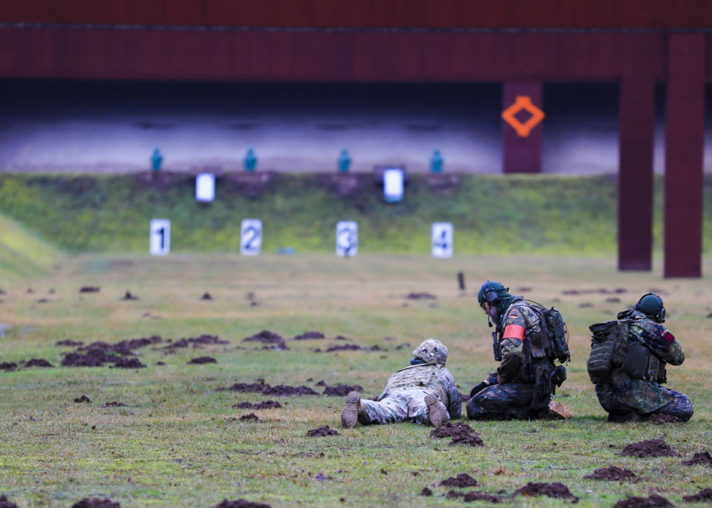U.S. Soldiers engage targets during the German Armed Forces Badge of Marksmanship, or Schützenschnur, at Breitenwald Range, Feb. 5. U.S. Soldiers joined German Armed Forces (Bundeswehr) Service Members for a chance to earn the badge.