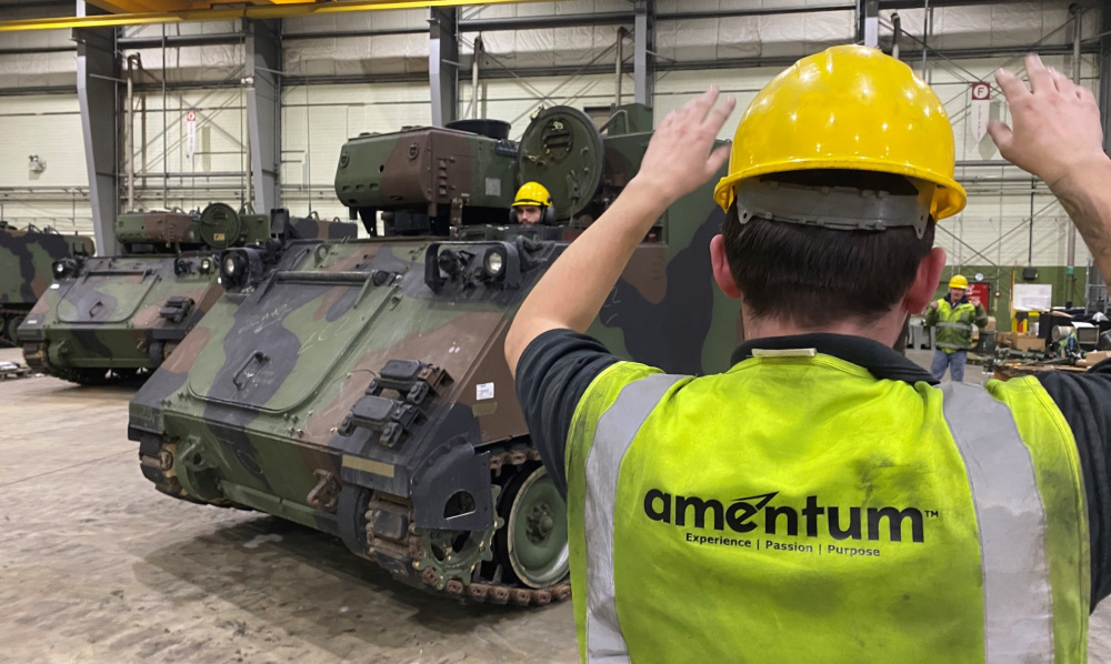 A contractor ground guides an armored personnel carrier inside one of the hangars at Coleman worksite. The 405th Army Field Support Brigade's Army Field Support Battalion-Mannheim is responsible for two Army Prepositioned Stock-2 sites. The one at Coleman Barracks houses an Armored Brigade Combat Team's worth of vehicles and equipment – forward – and ready to issue.