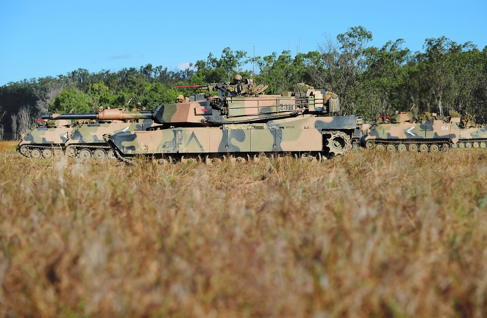 An M1A1 Abrams tank and M113AS4 armored fighting vehicles from the Adelaide-based 7th Battalion, Royal Australian Regiment, prepare to deploy with the Battle Group during Exercise Predator's Strike.