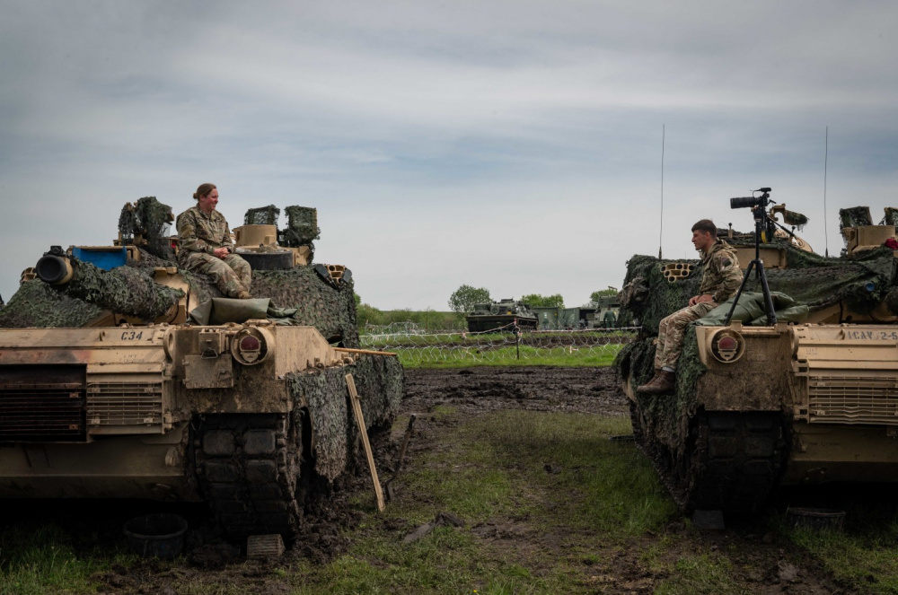 US Army First Lieutenant Katie Tenefrancia, platoon leader for the 3rd Platoon 'C' 25th Cavalry, is interviewed by Corporal Sebastian Drakeford, assigned to Allied Joint Force Command Naples, during Exercise Steadfast Defender 2021 in Romania.