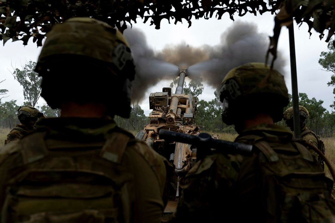 Australian Army soldiers from the 4th Regiment, Royal Australian Artillery, fire an M777 Howitzer during a fire mission on Exercise Chau Pha at Townsville Field Training Area on 22 May 2021.