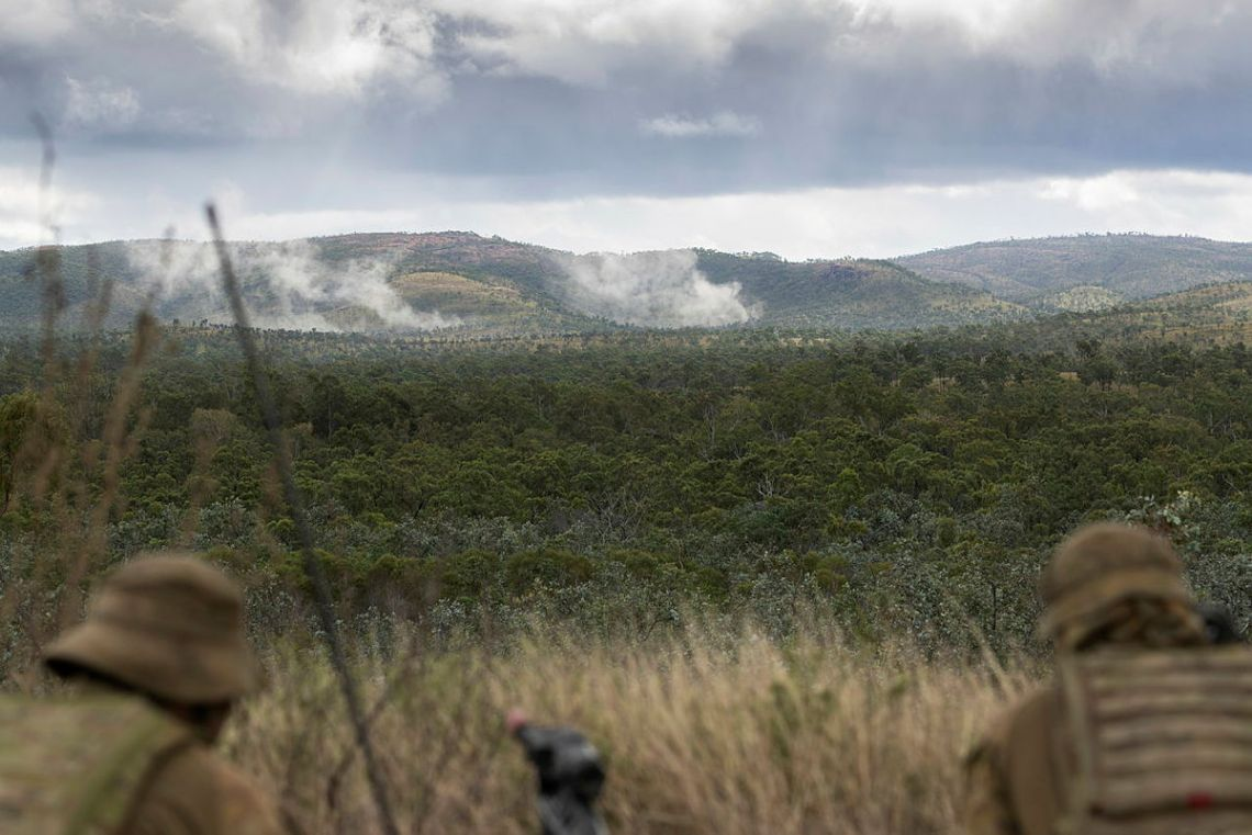 Australian Army soldiers from the 4th Regiment, Royal Australian Artillery, observe the target during Exercise Chau Pha at Townsville Field Training Area on 22 May 2021.