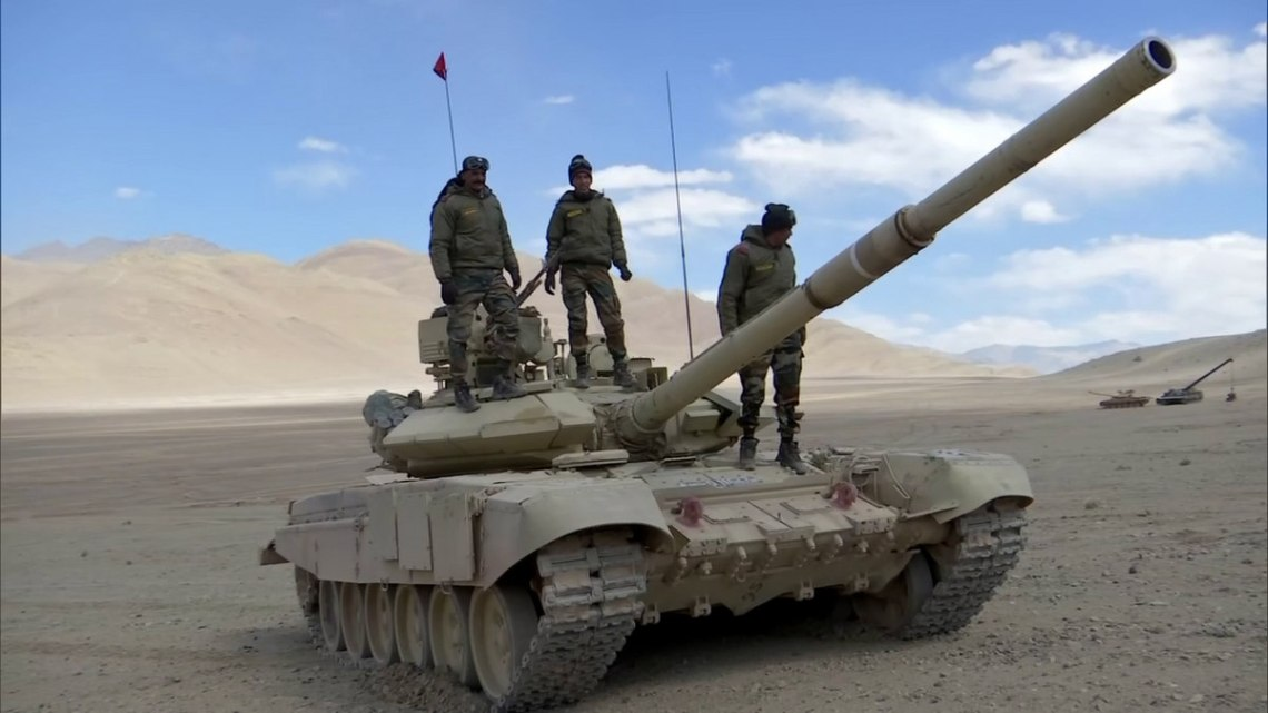 Indian Army soldiers atop a T-90 tank in Ladakh