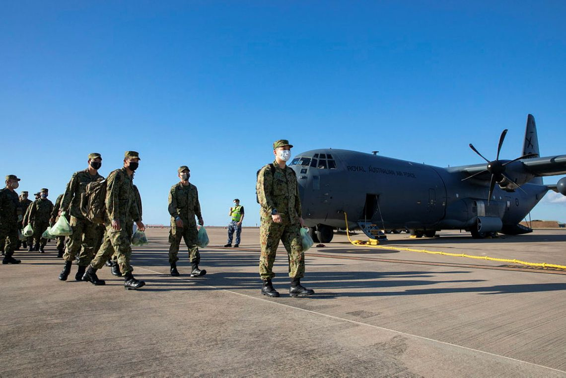 Soldiers from the Japan Ground Self-Defense Force make their way to the terminal from a Royal Australian Airforce C-130J Hercules after landing at RAAF Base Darwin, NT.