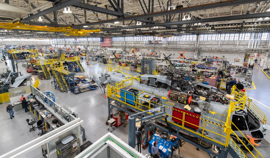 Sikorsky employees building CH-53K ™aircraft utilizing 3-D work instructions, new titanium machining centers with multi-floor ergonomic platforms.
