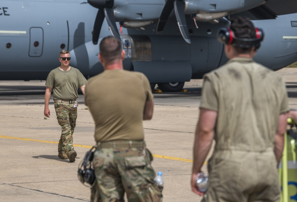 U.S. Air Force Master Sgt. Ren Forbes, C-130J Super Hercules loadmaster assigned to the 86th Airlift Wing, meets with a team of 86th Airlift Wing maintainers to finish pre-flight checks on a U.S. Air Force C-130J at the 3rd Royal Moroccan Air Force Base in Kenitra, Morocco, 11 June, 2021.