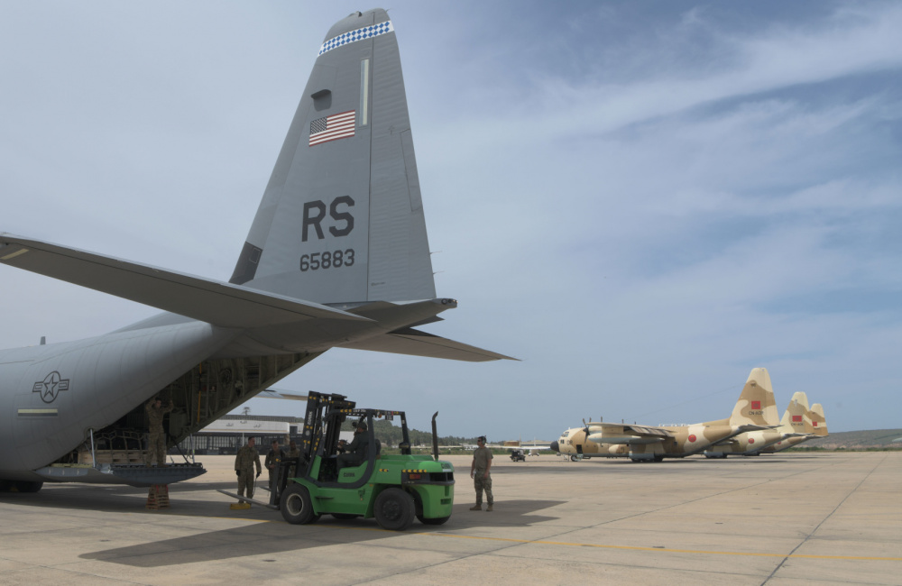 Moroccan military members unload supplies and equipment from an 86th Airlift Wing C-130J Super Hercules from Ramstein Air Base, Germany, at the 3rd Royal Moroccan Air Force Base in Kenitra, Morocco, 8 June, 2021. African Lion 2021 demonstrates the U.S. Air Force's long-term commitment to improve partner nation capacity and capabilities in support of U.S. strategic objectives.