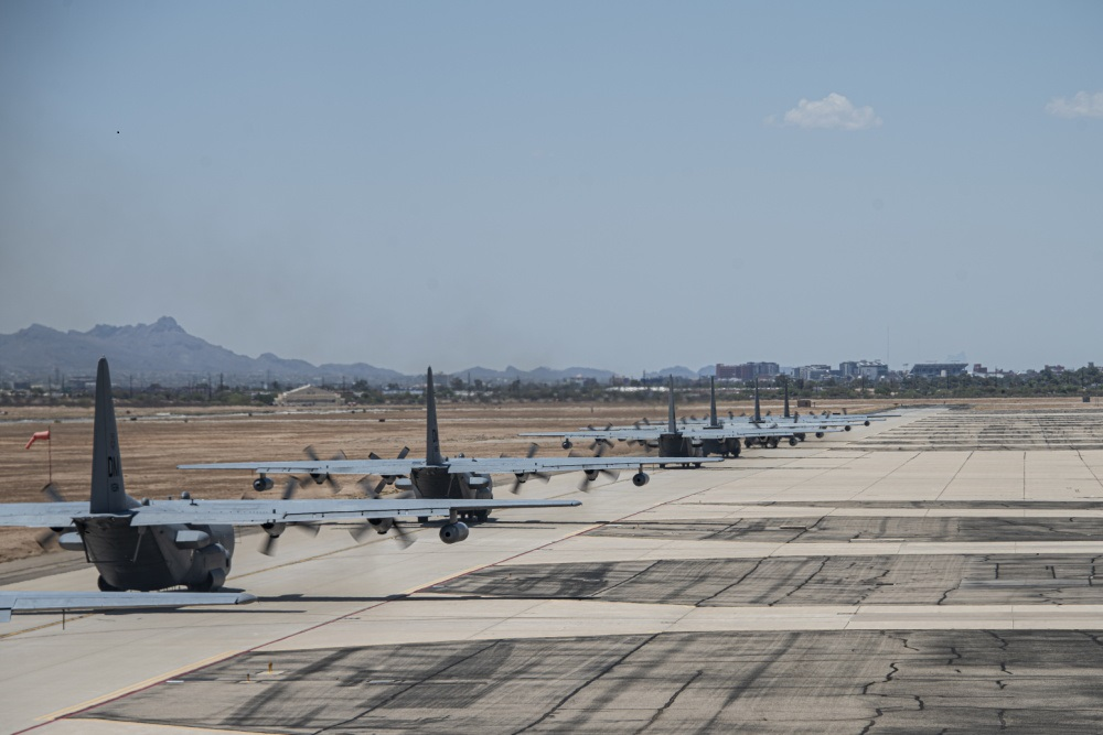 U.S. Air Force EC-130H Compass Calls taxi down the flight line during a show-of-force readiness exercise at Davis-Monthan Air Force Base, Arizona, June 28, 2021.