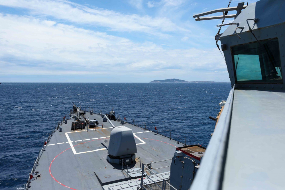 The Arleigh Burke-class guided-missile destroyer USS Ross (DDG 71) transits the Strait of Gibraltar, June 19, 2021.