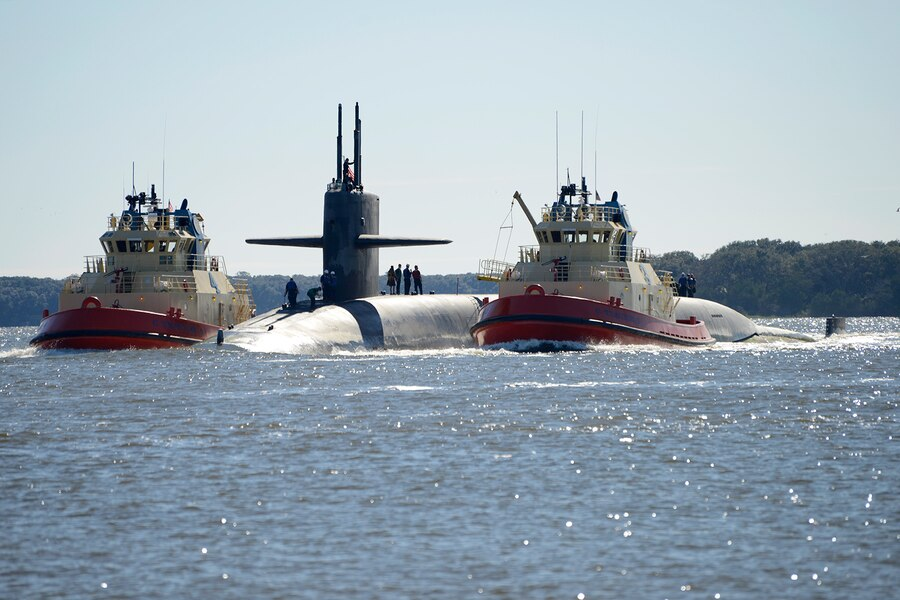 The Ohio-class ballistic-missile submarine USS Tennessee (SSBN 734) (Blue) returns to homeport at Naval Submarine Base Kings Bay, Ga., following a strategic deterrent patrol. The ship is one of six ballistic-missile submarines stationed at the base and is capable of carrying up to 20 submarine-launched ballistic-missiles with multiple warheads. (U.S. Navy photo by Mass Communication Specialist 1st Class Ashley Berumen)
