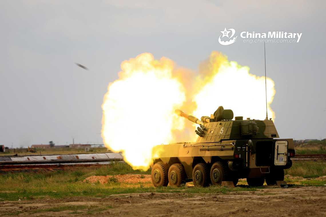 Chinese People's Liberation Army Navy Marine Corps (PLANMC) PLL-09 self-propelled howitzer conducts live firing drills.