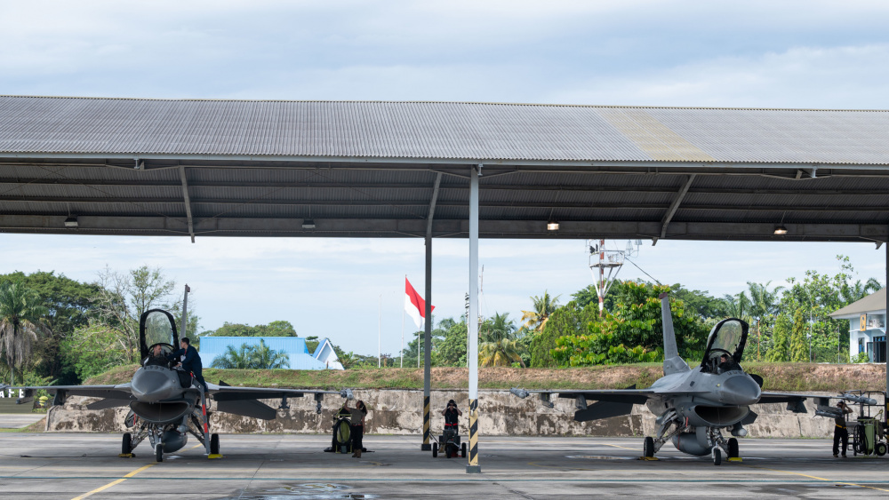U.S. Air Force Airmen with the 35th Fighter Wing, Misawa Air Base, prepare F-16 Fighting Falcons for flight in support of Cope West 21 at Roesmin Nurjadin Air Force Base in Pekanbaru, Riau, Indonesia, June 16, 2021.