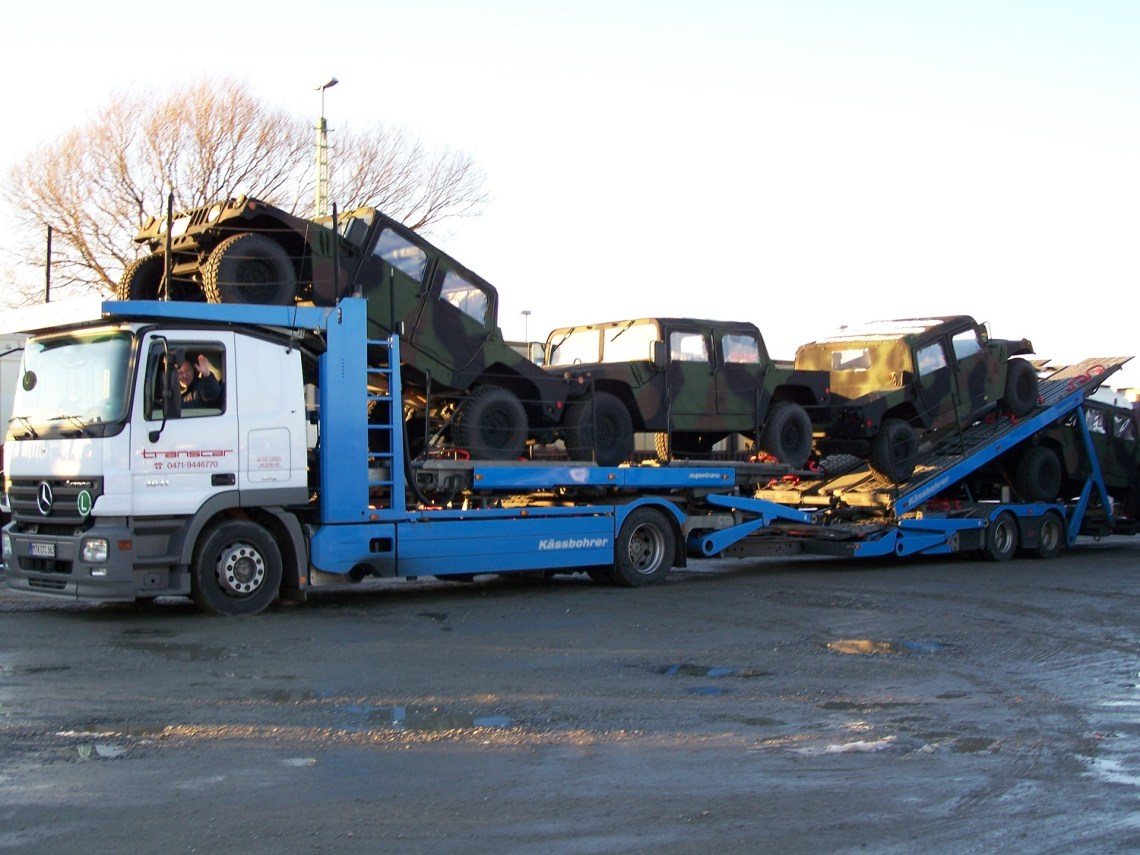 ARC can arrange inland transportation of your cargo. Here, POVs arrive at Bremerhaven for loading.