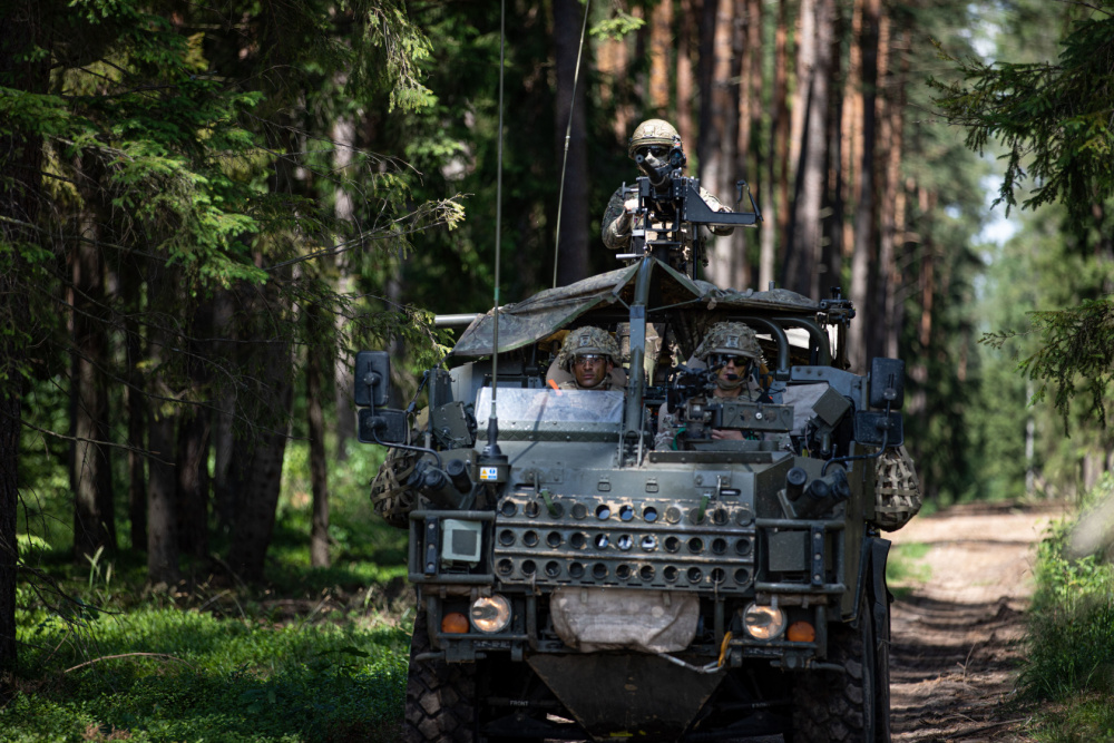 """British Army soldiers operate a """"Jackal"""" vehicle during deployment readiness exercise """"Rifle Ready"""" at Bemowo Piskie Training Area, Poland, July 1, 2021."""