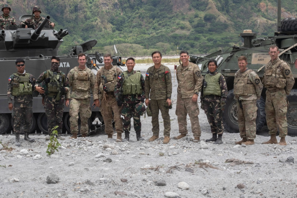 U.S. and Philippine Army soldiers pose for a photo after the commencement of the Combined Arms Live Fire Exercise at Colonel Ernesto Ravina Air Base, Philippines during Exercise Balikatan
