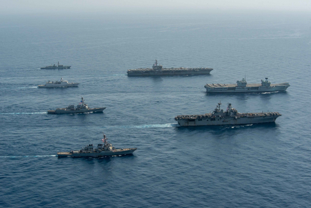Ships of the UK Carrier Strike Group, USS Ronald Reagan Carrier Strike Group, and Iwo Jima Amphibious Ready Group operate in formation in the Gulf of Aden, July 12. UK, Dutch and U.S. naval forces conducted an integrated at-sea exercise designed to enhance maritime interoperability and demonstrate naval integration through a series of training scenarios.
