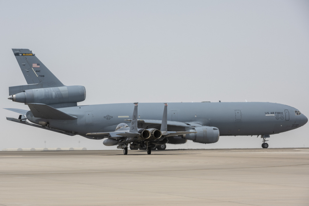 A KC-10 Extender from the 908th Expeditionary Air Refueling Squadron and an F-15E Strike Eagle assigned to the 494th Expeditionary Fighter Squadron prepare for takeoff July 5, 2021 from Al Dhafra Air Base, United Arab Emirates.