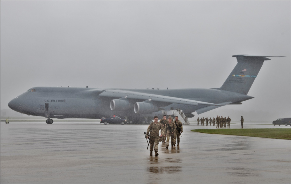 An Air Force C-5M Super Galaxy and aircrew from Dover Air Force Base, Del., carrying Soldiers with the 3rd Brigade Combat Team, 10th Mountain Division of Fort Polk, La., parks on a parking ramp July 7, 2021, as part of an Emergency Deployment Readiness Exercise (EDRE) at Volk Field, Wis.