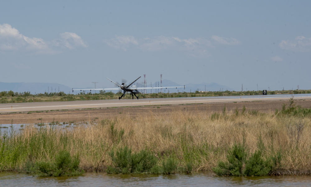An MQ-9 Reaper from Creech Air Force Base, Nevada, prepares to take off from Holloman AFB, New Mexico, July 8, 2021. This is the first time an MQ-9 arrive at HAFB from a different base using a new automated landing and takeoff system without an aircrew.