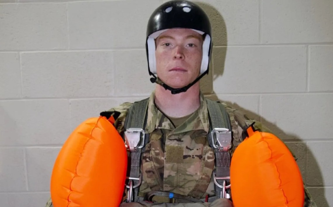 An Airborne and Special Operations Test Directorate soldier prepares to enter the water prior to the start of Parachutist Flotation Device (PFD) pool testing.