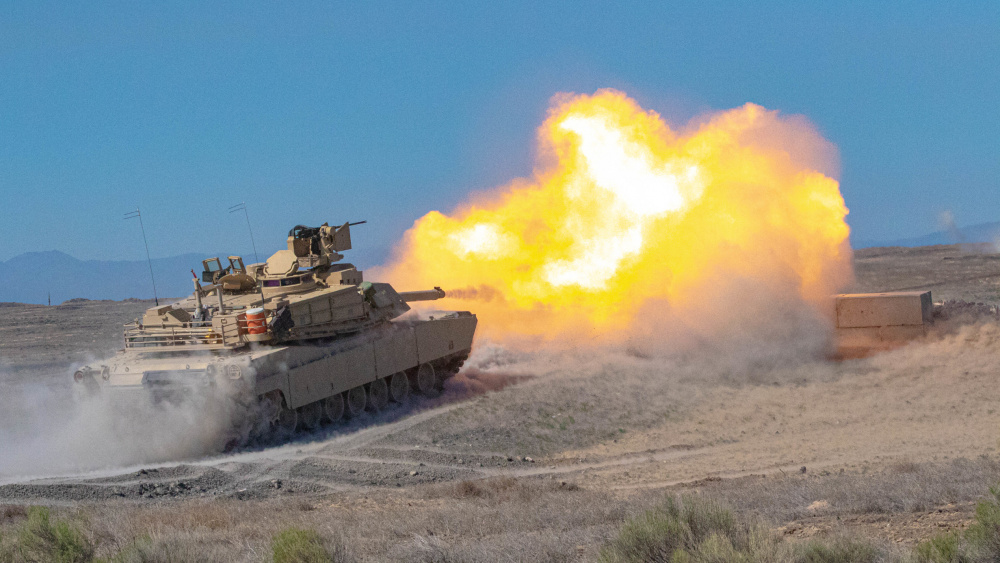 Oregon Army National Guard M1A2 Abrams battle tank with Alpha Troop, 3rd Squadron, 116th Cavalry Regiment, engages a target at a firing range during annual training at the Orchard Combat Tranining Center