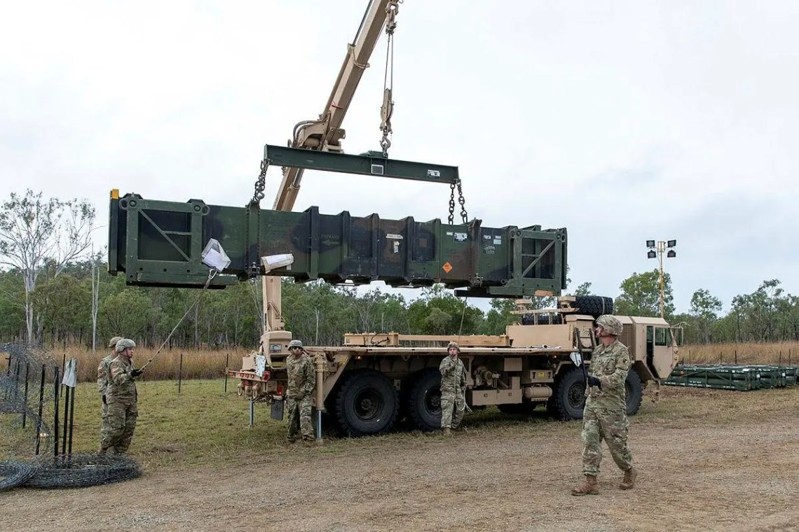 U.S. Army personnel load a Patriot missile on to a guided missile transporter vehicle in the lead-up to a live-fire event to be held at Shoalwater Bay in Queensland during Exercise Talisman Sabre.