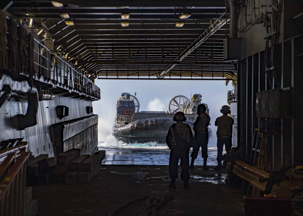 Landing Craft, Air Cushion (LCAC) 28, attached to Assault Craft Unit (ACU) 2, enters the well deck of the Harpers Ferry-class dock landing ship USS Carter Hall (LSD 50), June 21, 2021.