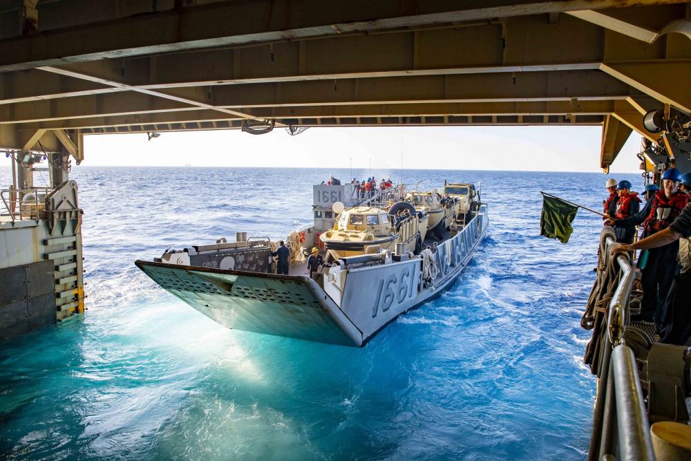Landing Craft, Utility (LCU) 1661, attached to Assault Craft Unit (ACU) 2, departs the well deck of the Harpers Ferry-class dock landing ship USS Carter Hall (LSD 50), June 21, 2021.