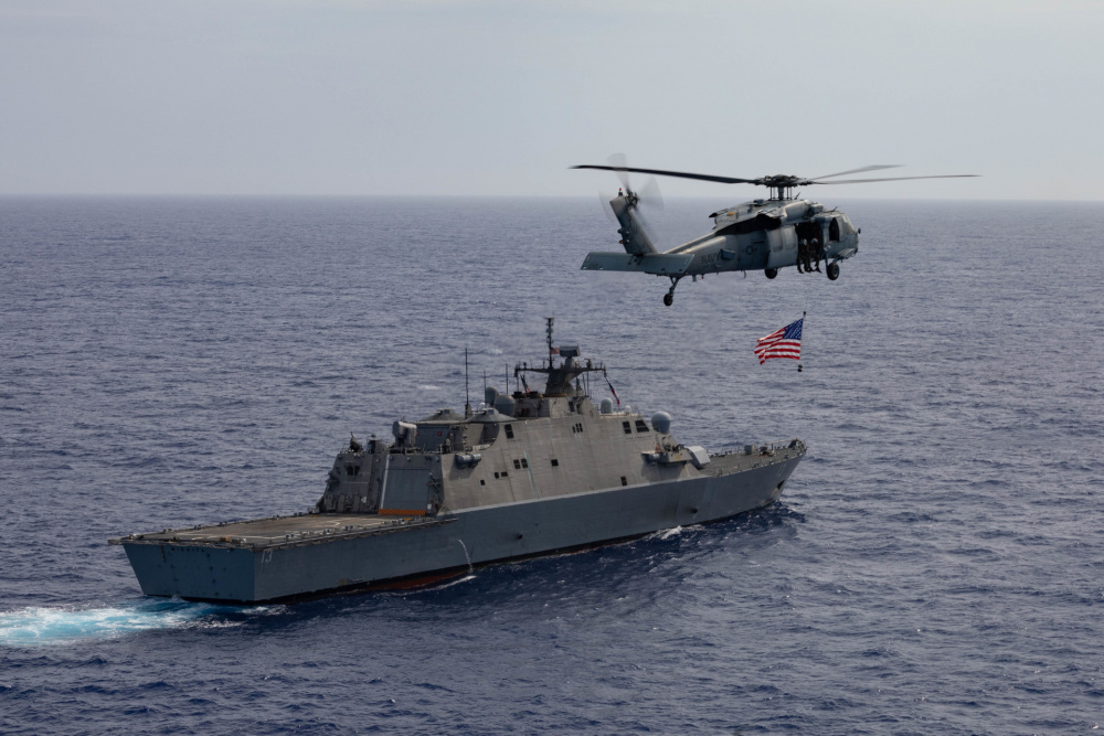 The Freedom-variant littoral combat ship USS Wichita (LCS 13) and its embarked aviation detachment participates in a maritime training exercise