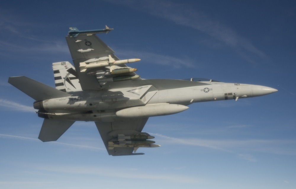 An F/A-18F Super Hornet assigned to the Salty Dogs of Air Test and Evaluation Squadron (VX) 23 conducts a captive carry flight test of an AGM-88E Advanced Anti-Radiation Guided Missile at Naval Air Station Patuxent River, Md.