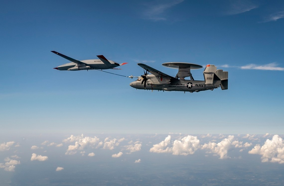 An MQ-25 Stingray unmanned aerial vehicle refuels an E-2D Advanced Hawkeye aircraft over MidAmerica Airport in Mascoutah, Ill., Aug. 18, 2021.