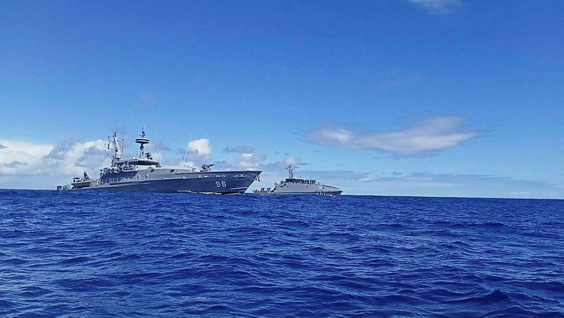 Royal Australian Navy Patrol Boat HMAS Glenelg conducts cooperative maritime surveillance activities with the Republic of Fiji Navy's Guardian Class Patrol Boat RFNS Savenaca
