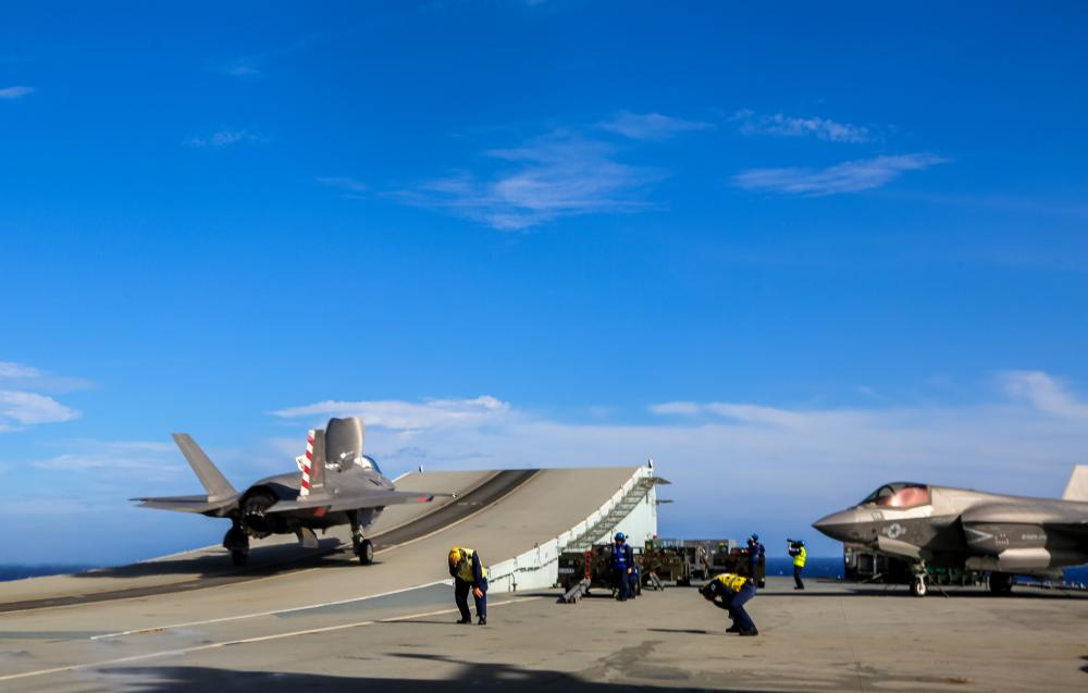 U.S. Marine Corps Maj Brian Kimmins prepares to launch an F-35B from HMS Queen Elizabeth for a historic cross-deck operation with USS America in the Pacific Ocean on August 20, 2021.