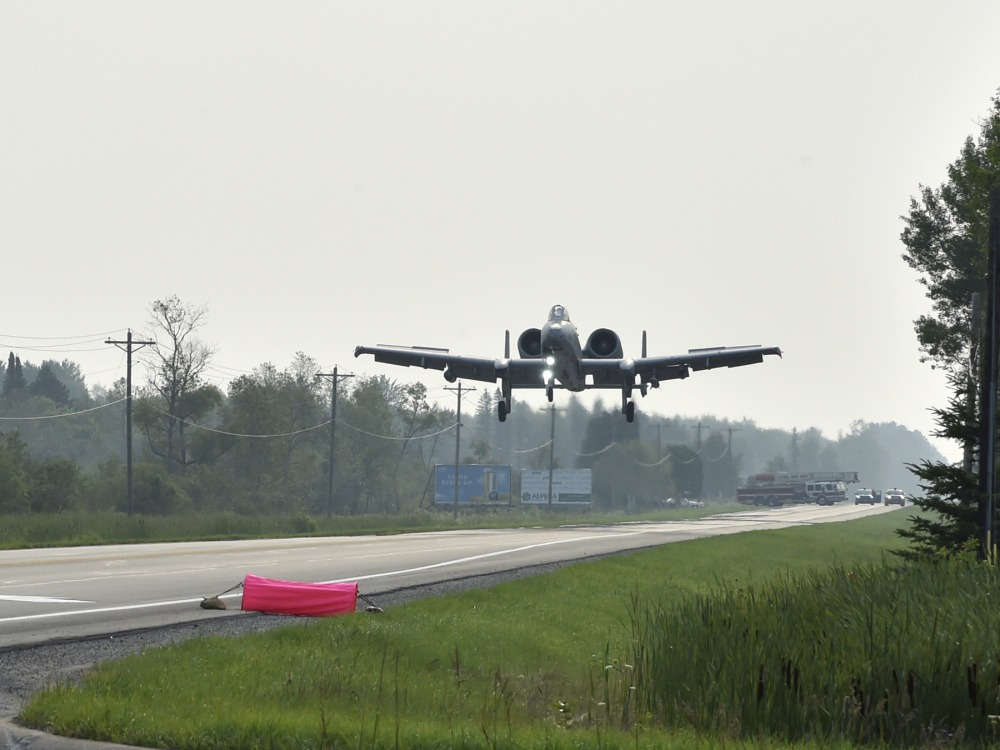 An A-10 Thunderbolt II pilot, 127th Wing, Selfridge Air National Guard Base, prepares to landon a pubic highway here, August 5, 2021. The training event marked the first time in U.S. history that a modern military aircraft landed on a U.S. public highway designed only for automobiles.
