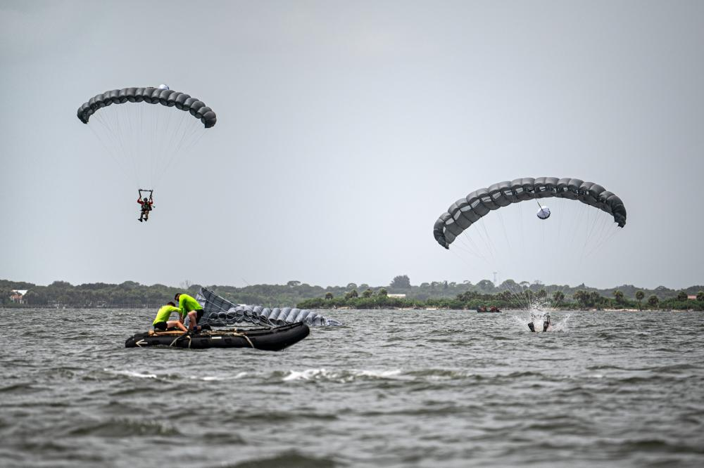 U.S. Air Force pararescuemen assigned to the 38th Rescue Squadron land in the Banana River during water jump training near Patrick Space Force Base, Florida, Aug. 24, 2021.