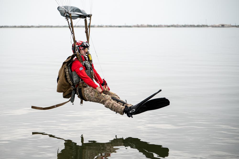 U.S. Air Force Tech. Sgt. Michael Galindo, 38th Rescue Squadron pararescueman Blue Team section chief, prepares to land in the Banana River during water jump training near Patrick Space Force Base, Florida, Aug. 24, 2021.