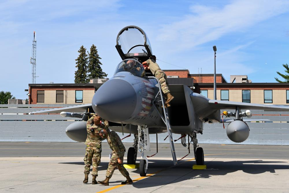 Crew chiefs with the 104th Fighter Wing's Aircraft Maintenance Squadron recieve and process F-15 Eagles during a mobility exercise August 15, 2021, at Barnes Air National Guard Base, Massachusetts.