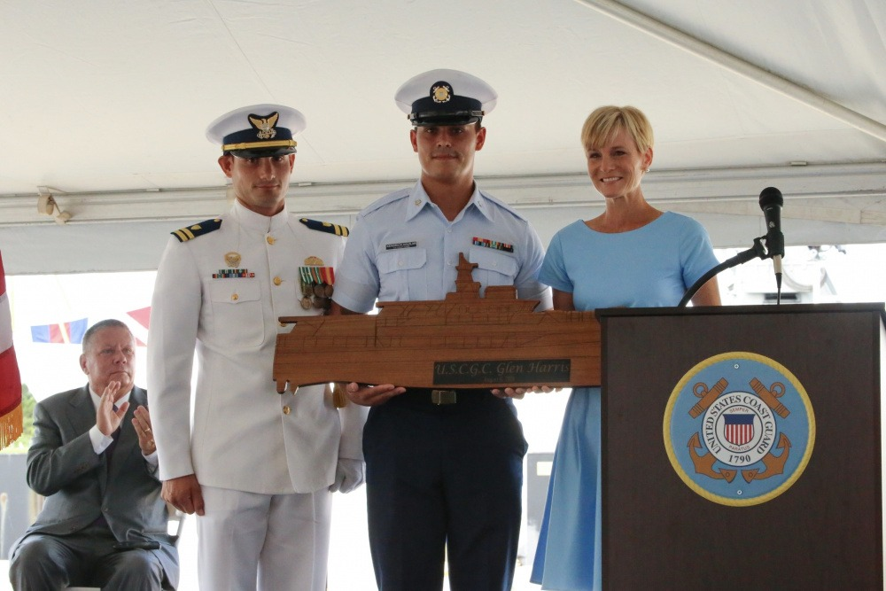 Lt. Reginald Reynolds, commanding officer of the Coast Guard Cutter Glen Harris, Petty Officer Third Class Kendrick Aguilar and Ms. Stacy Howley, the vessel's sponsor, pose for a photo during the vessel's commissioning ceremony at Coast Guard Sector Field Office Fort Macon in Beaufort, North Carolina, Aug. 6, 2021.